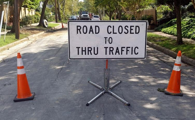 Street sign indicating the road is closed